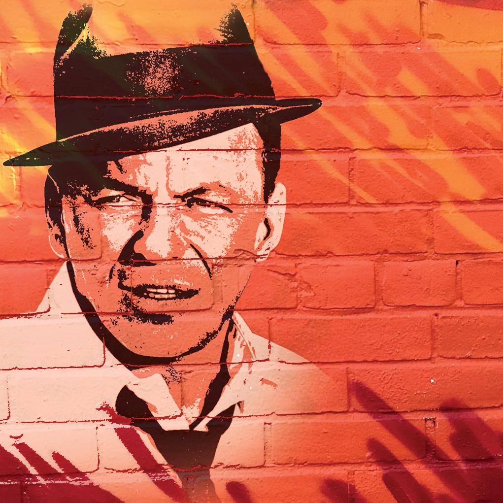 Bild av Frank Sinatra på orange tegelvägg